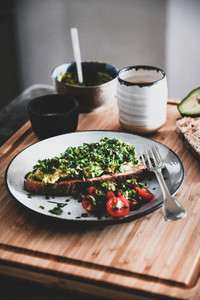 Healthy breakfast with avocado toast and espresso coffee on board