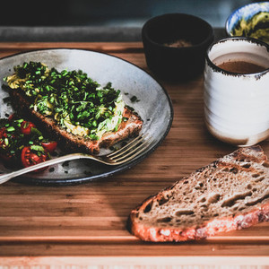 Vegan meal with avocado toast and coffee  square crop