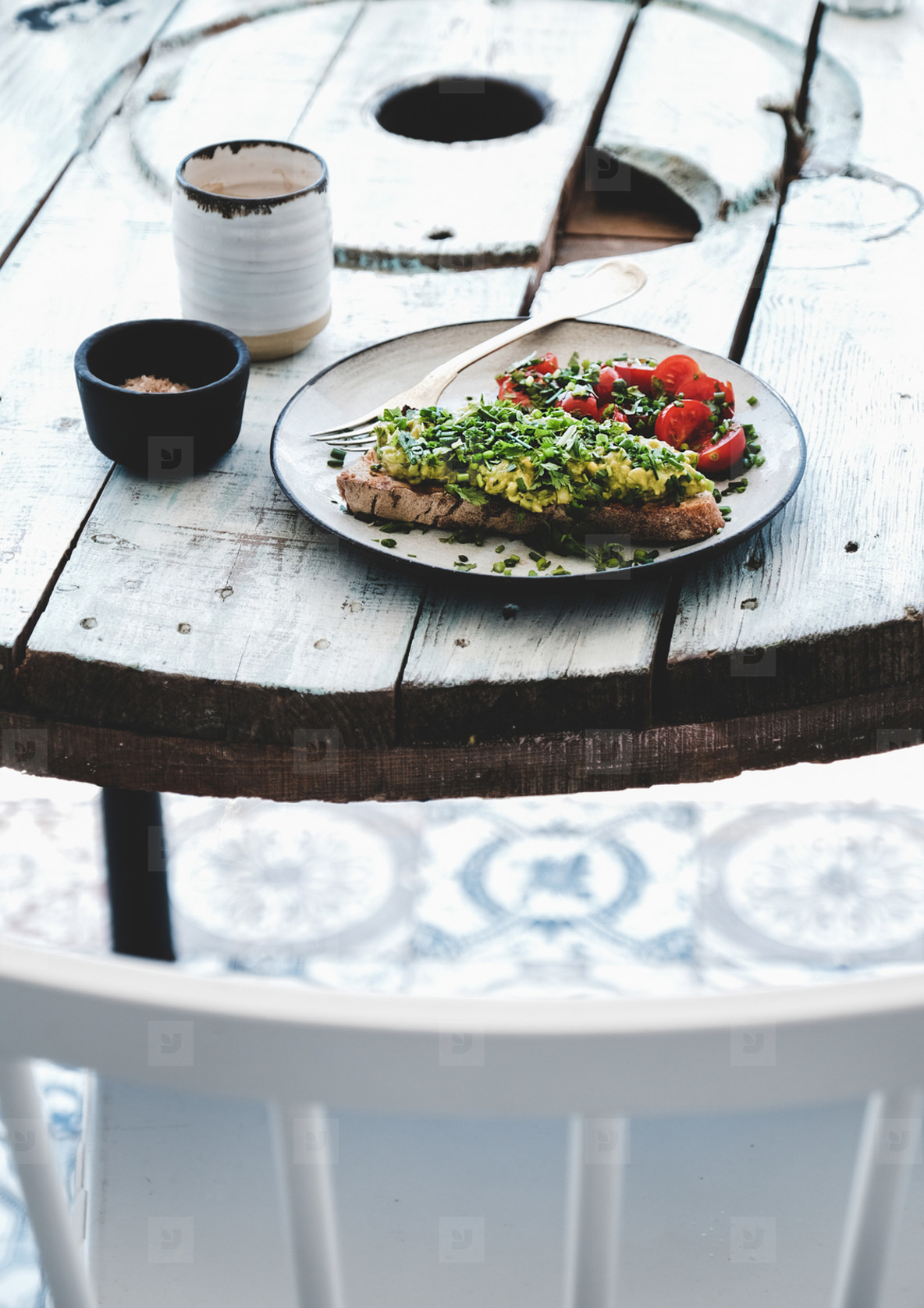 Healthy Vegan lunch with avocado toast and coffee on table