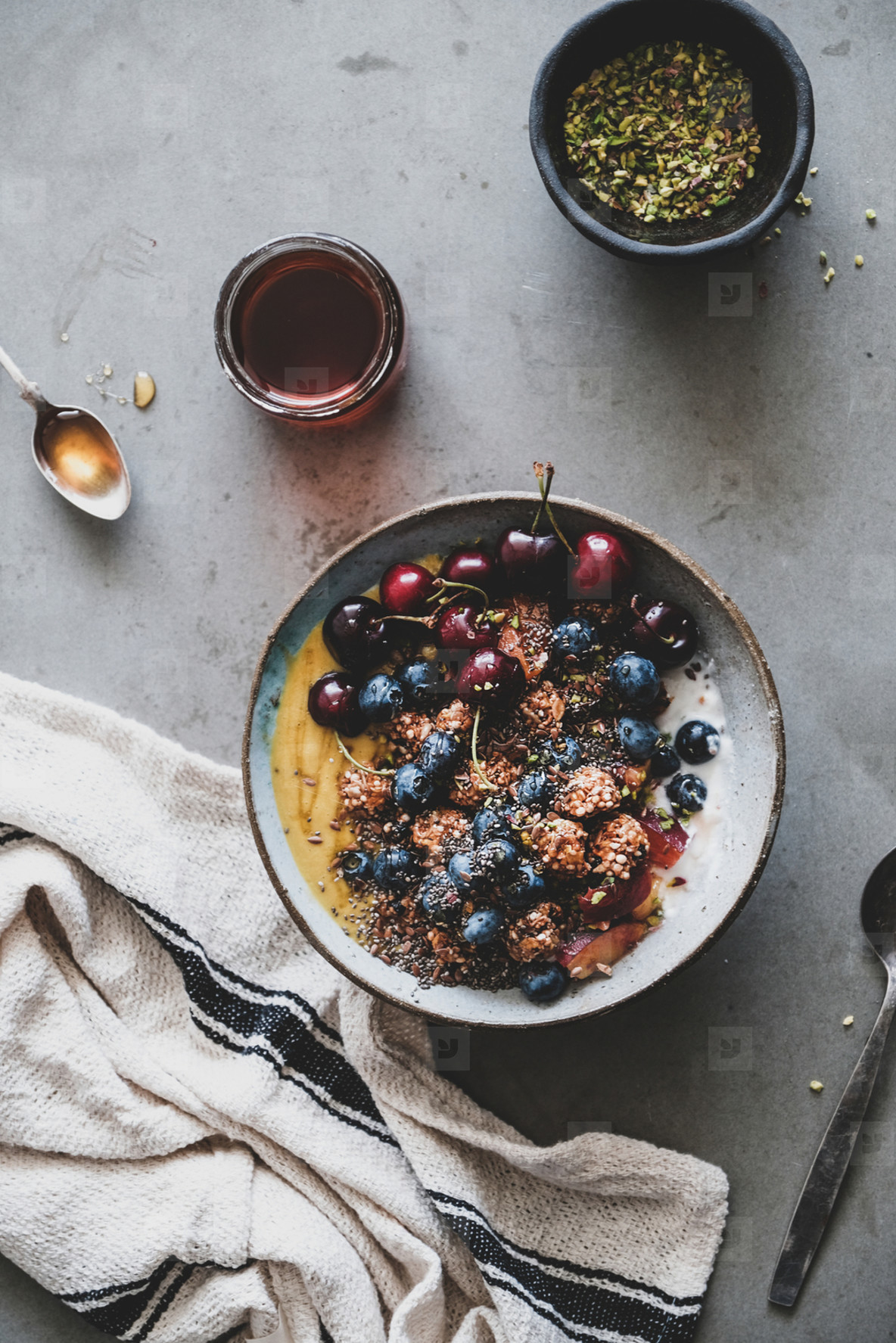 Healthy vegan breakfast with quinoa granola coconut yogurt bowl