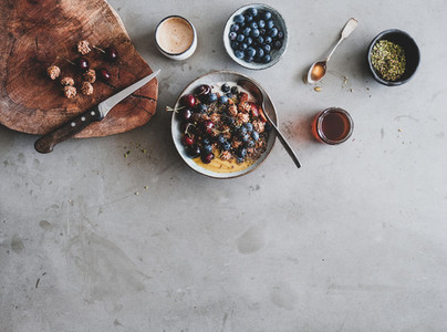 Healthy breakfast set with granola yogurt bowl and coffee