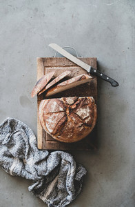 Freshly baked sourdough wholegrain bread on rustic wooden board