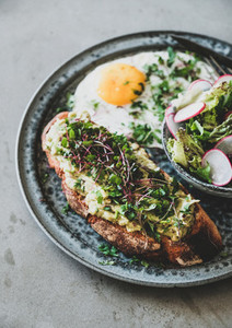 Avocado toast  fried egg and salad with radish