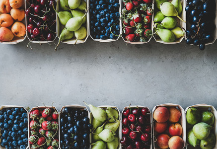 Summer fruit and berry assortment in wooden boxes  copy space