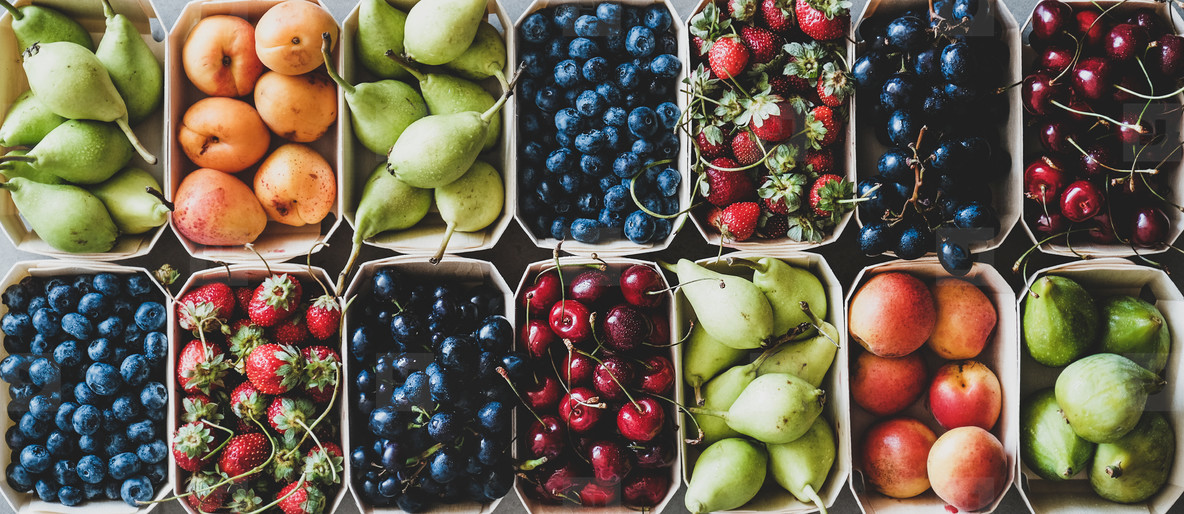 Summer fruit and berry assortment in wooden boxes  top view