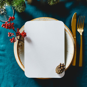 Festive table setting with winter decor and mockup  The concept of Thanksgiving or Christmas family dinner