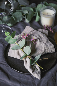 Festive table setting with floral decor  The concept of Thanksgiving or wedding dinner