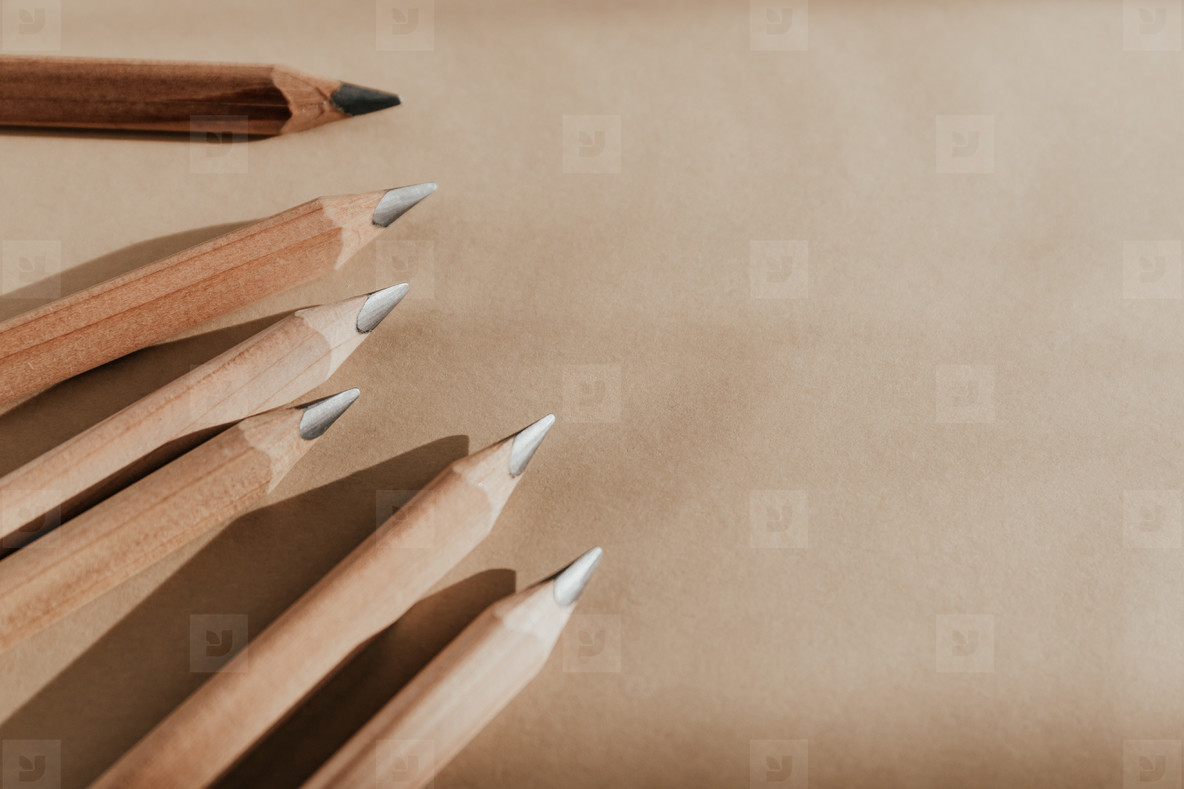 Close up of pencils on kraft paper with copy space
