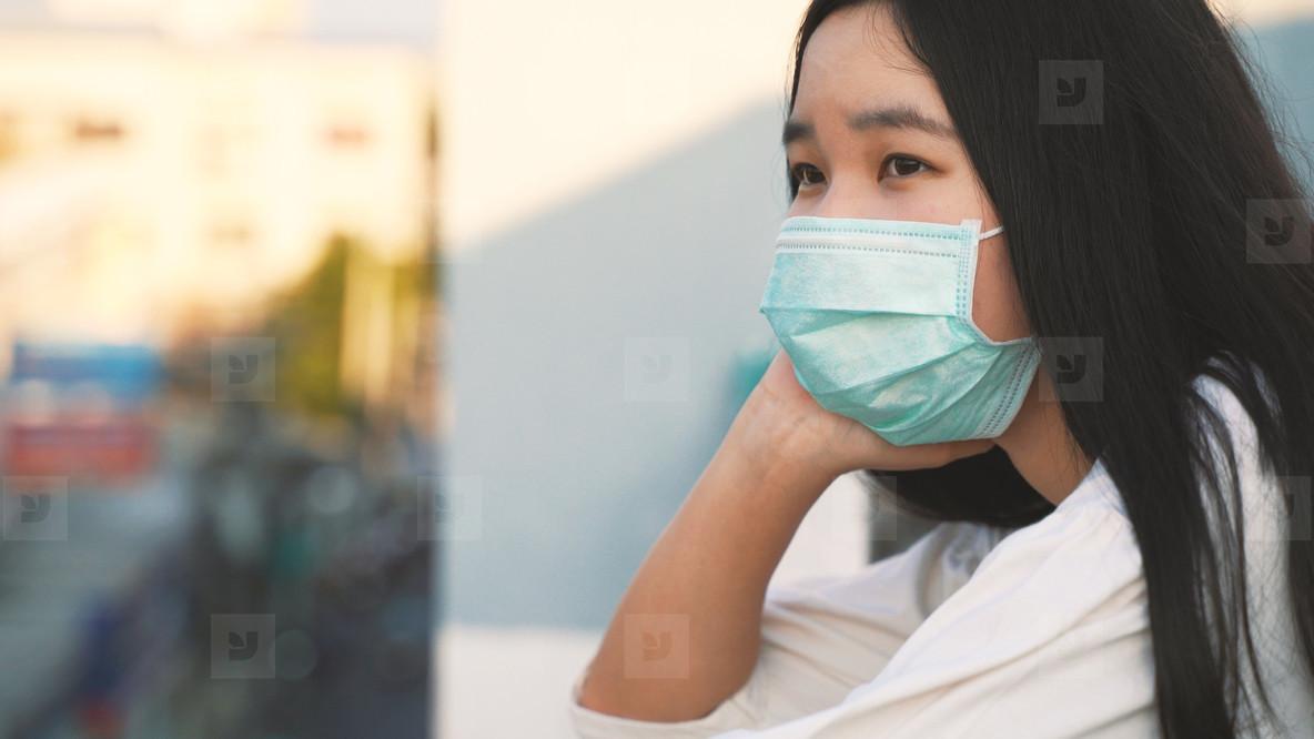 Young asian millennial gen z woman standing at rooftop feeling b