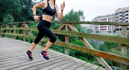 Woman running through an urban park