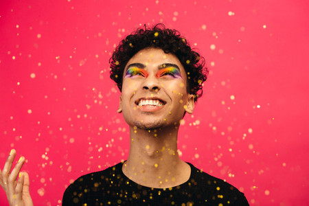 Transgender man playing with glitter