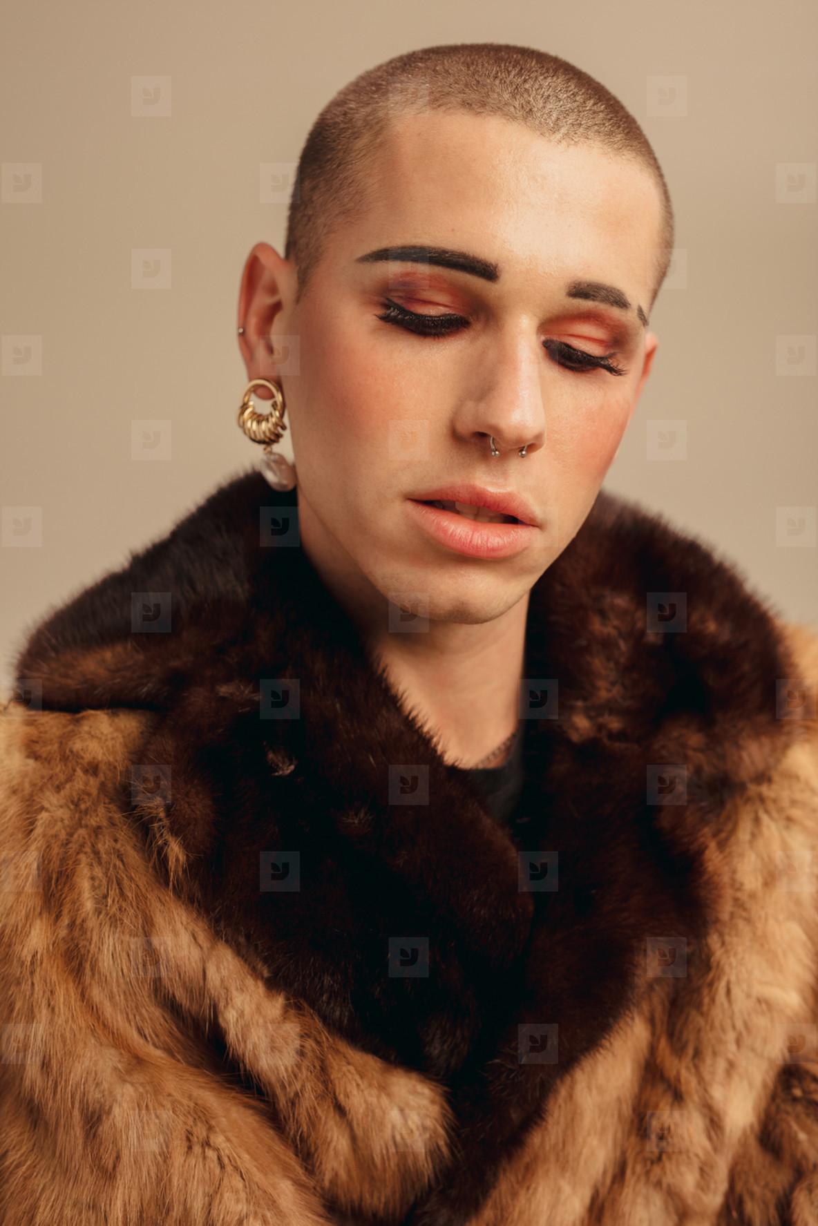 Fashionable gay man in fur coat