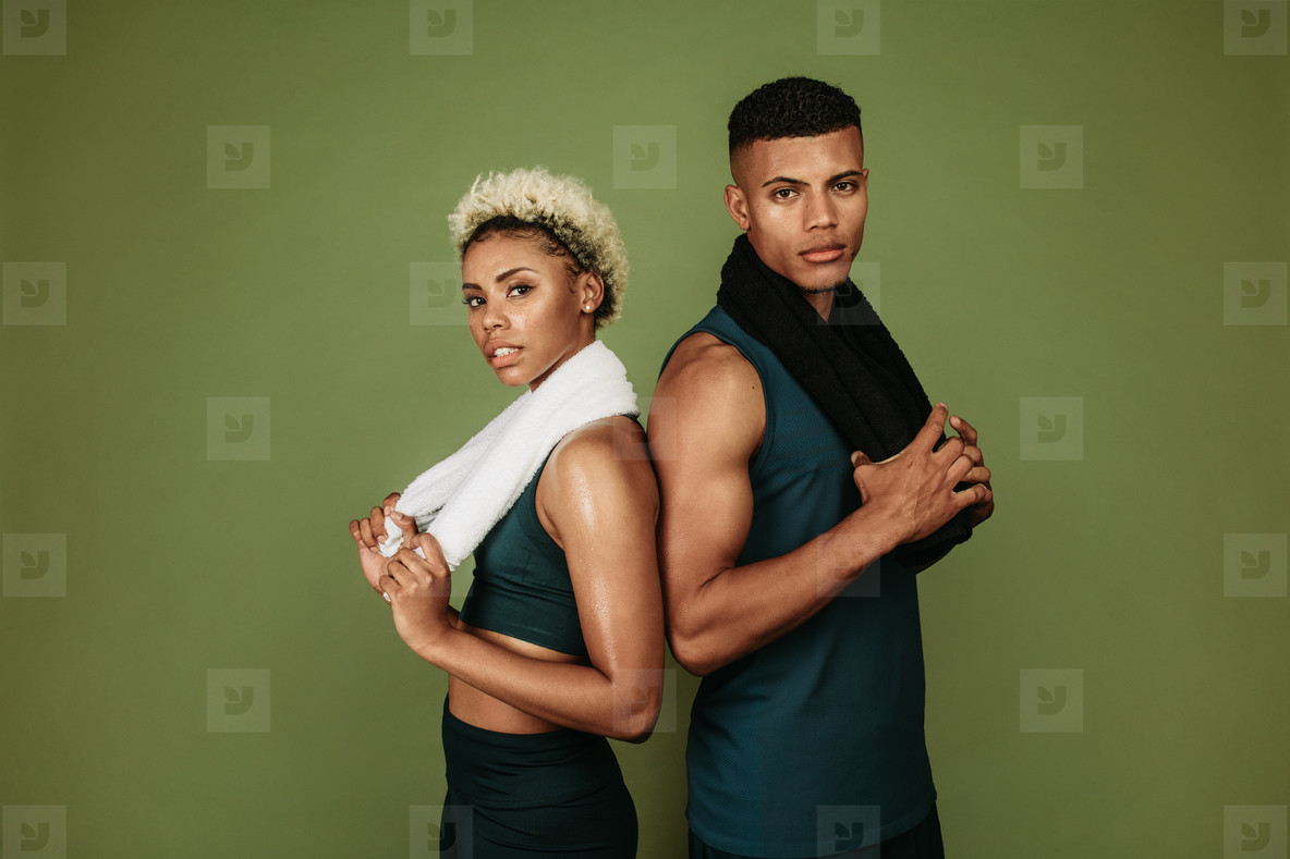 Fitness couple standing together after workout