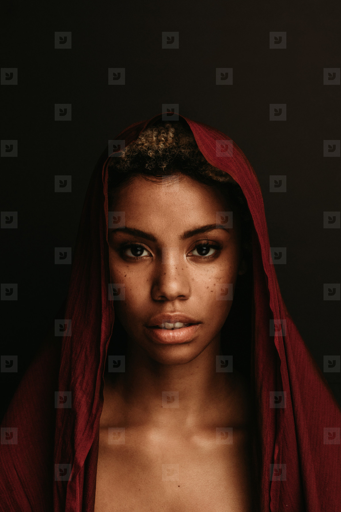 Portrait of african american woman on black background