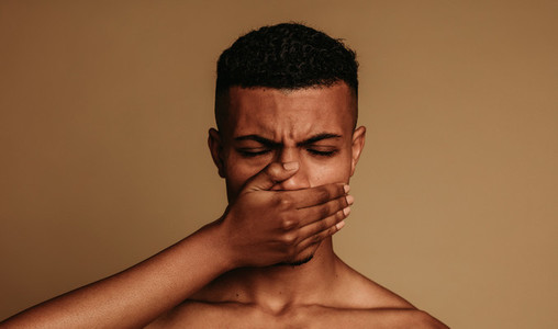 Close up of african american man struggling to breathe