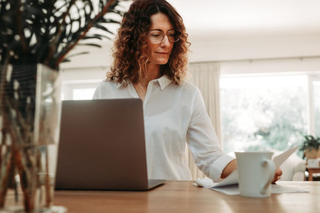 Woman going over paperwork at home