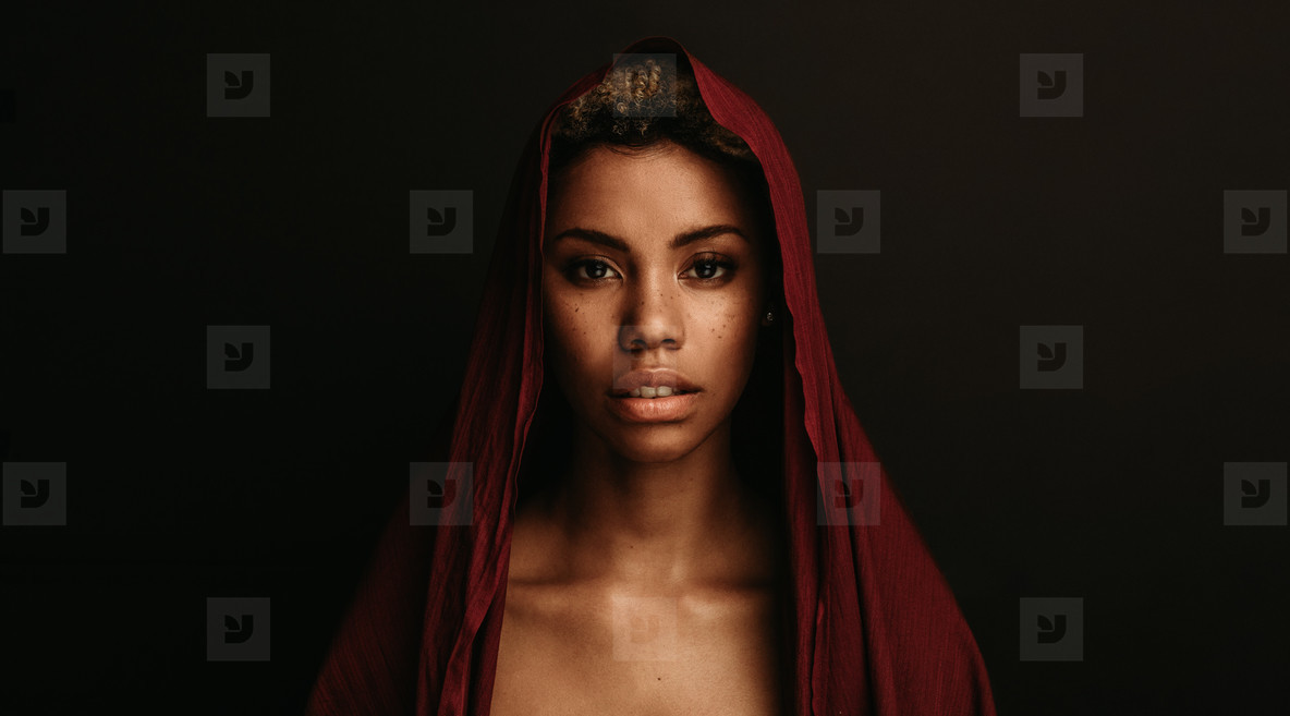 African american woman with traditional cloth over her head