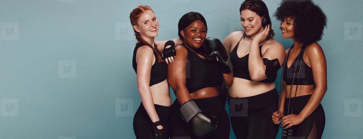 Women of different race and body size in sportswear