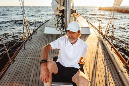 Senior man sitting on a deck