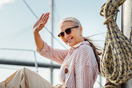 Happy woman wearing sunglasses