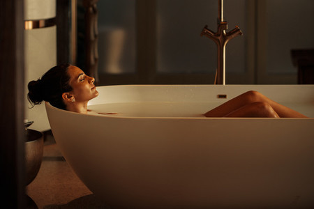 Woman lying in a luxury bathtub