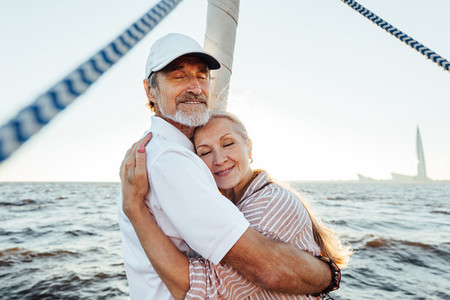 Happy elderly people embracing