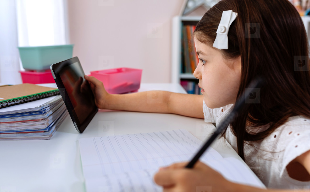 Girl doing homework with the tablet