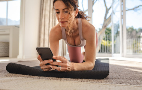 Woman using fitness apps for workout