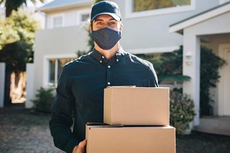 Delivery man delivering online shopping order