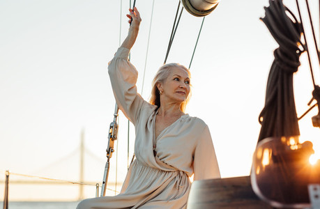 Mature woman on private sailboat