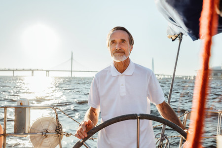 Mature man steering a private