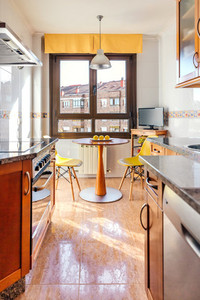 Kitchen on two fronts with dining area