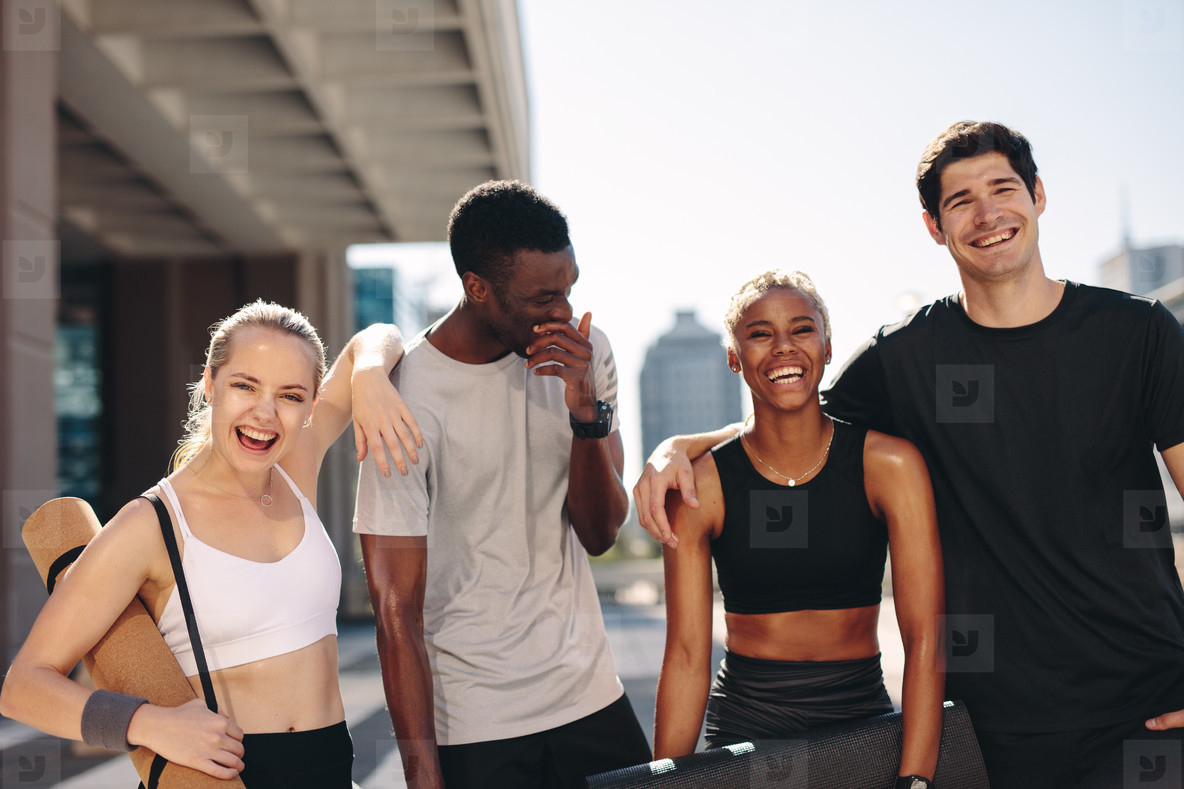 Cheerful friends after workout session outdoors