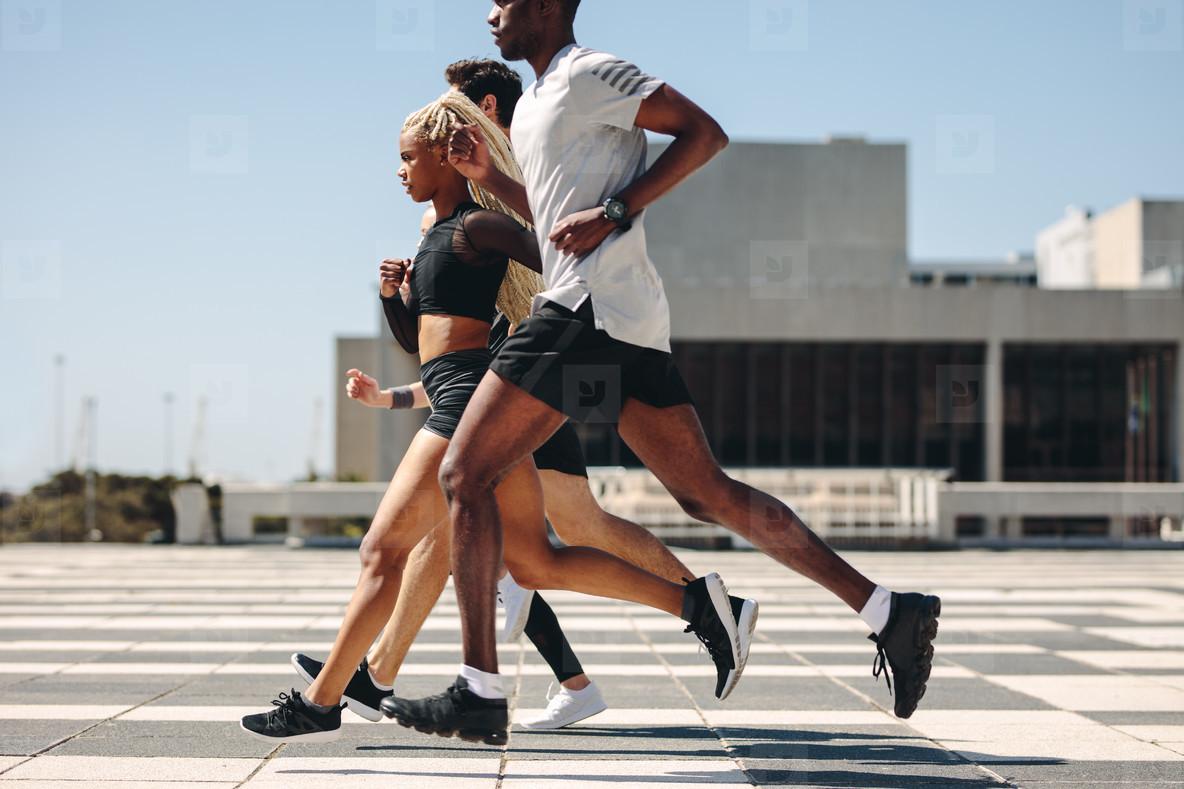 Street runner exercising in the city