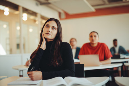 Thoughtful student in college classroom