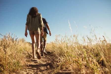 Couple trekking on a rocky hillock