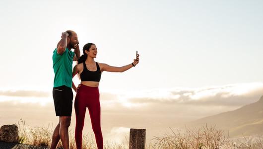 Running couple taking selfie
