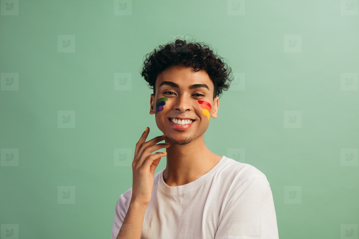 Man with face paint celebrates gay pride