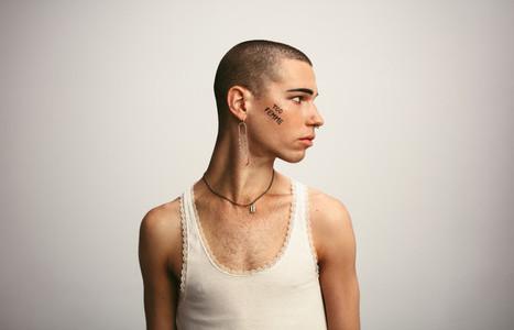 Transgender male in a tank top