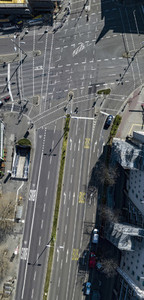 Aerial view sunny intersecting city streets  Germany