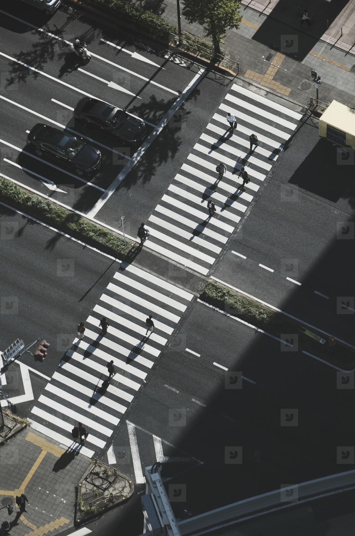 Aerial view pedestrians crossing city street at crosswalk Tokyo  Japan