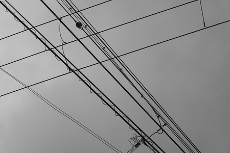 Cable car lines below overcast sky
