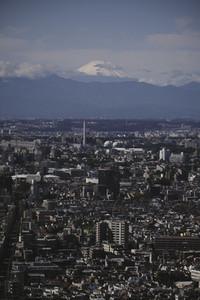 Mount Fuji over sunny Tokyo cityscape Japan