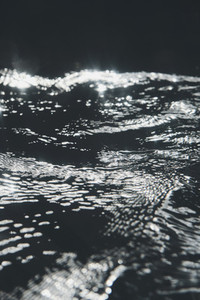 Sunlight and ripple pattern over water surface