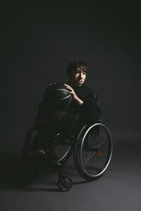 Male paraplegic athlete with basketball in wheelchair