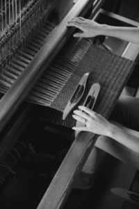 Woman working at loom in workshop