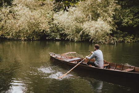 Man rowing canoe on tranquil River Avon Bath Somerset UK