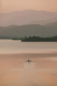Rowboat on tranquil lake at sunset Whiskeytown USA