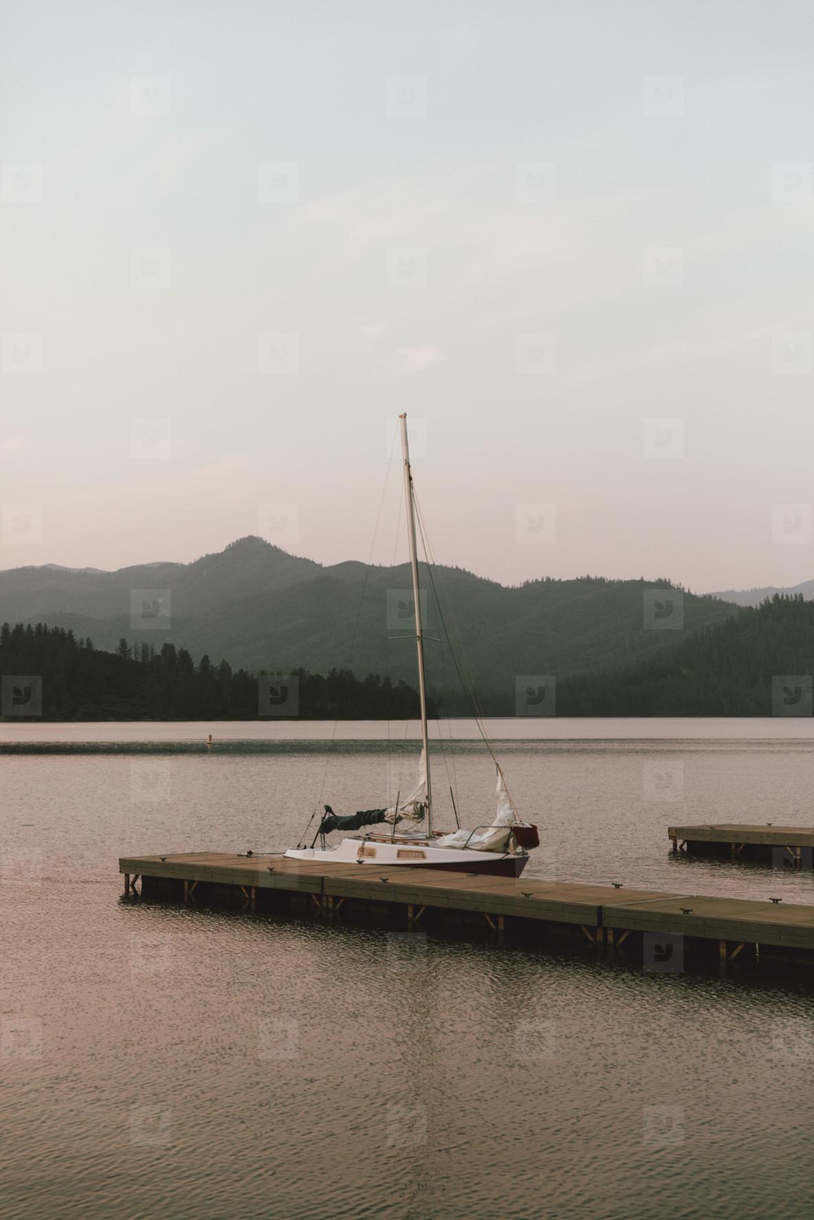 Sailboat moored at dock on tranquil Whiskeytown  USA