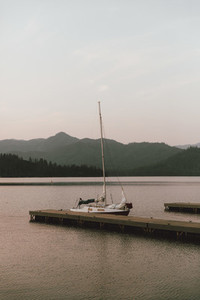 Sailboat moored at dock on tranquil Whiskeytown USA